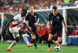 March 23, 2018 - Miami Gardens, Florida, USA - Croatia midfielder Ivan Perisic (4) drives the ball past Peru defender Luis Advincula (17) during a FIFA World Cup 2018 preparation match between the Peru National Soccer Team and the Croatia National Soccer Team at the Hard Rock Stadium in Miami Gardens, Florida. (Credit Image: © Mario Houben via ZUMA Wire)