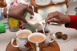 Making cups of tea,