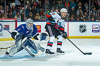 KELOWNA, BC - JANUARY 8: Shane Farkas #1 of the Victoria Royals defends the net as Matthew Wedman #20 of the Kelowna Rockets looks for the pass and opportunity to shoot on net during first period at Prospera Place on January 8, 2020 in Kelowna, Canada. (Photo by Marissa Baecker/Shoot the Breeze)