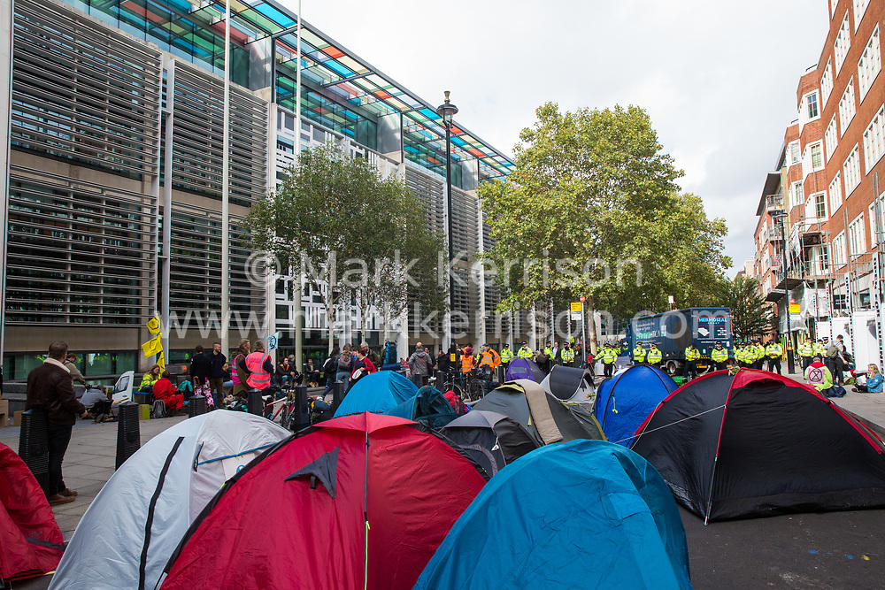 London, UK. 8 October, 2019. Tents pitched by climate activists from Extinction Rebellion blocking Marsham Street in front of the Home Office on the second day of International Rebellion protests to demand a government declaration of a climate and ecological emergency, a commitment to halting biodiversity loss and net zero carbon emissions by 2025 and for the government to create and be led by the decisions of a Citizens' Assembly on climate and ecological justice.