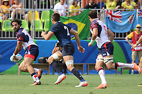 August 09, 2016; Rio de Janeiro, Brazil; USA Men's Eagles Sevens Nate Ebner breaks away from the Argentinian defense during the Men's Rugby Sevens Pool A match on Day 4 of the Rio 2016 Olympic Games at Deodoro Stadium. Photo credit: Abel Barrientes - KLC fotos
