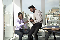 Sep. 04, 2010 - Two men discussing mobile telephone. Model and Property Released (MR&PR) (Credit Image: © Cultura/ZUMAPRESS.com)