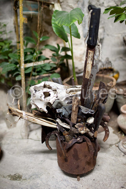 As adherants of Santeria receive their initiations for the different Orisha they get a physical representation of the 'saint'. Santeria is a syncretic religion practiced in Cuba, it is a mixture of Yoruba tribal practices brought from Nigeria during Colonial times, and traditional Catholic beliefs. During this time, the slaves used the images of saints to cover up their worship of the Orishas (spirits).