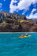 Sea kayaking along the Na Pali Coast, Island of Kauai, Hawaii USA