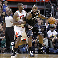 29 January 2012: Chicago Bulls shooting guard Ronnie Brewer (11) defends on Miami Heat small forward LeBron James (6) during the Miami Heat 97-93 victory over the Chicago Bulls at the AmericanAirlines Arena, Miami, Florida, USA.