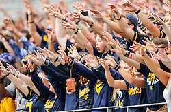 Sep 22, 2018; Morgantown, WV, USA; West Virginia Mountaineers students celebrate a first down during the first quarter against the Kansas State Wildcats at Mountaineer Field at Milan Puskar Stadium. Mandatory Credit: Ben Queen-USA TODAY Sports
