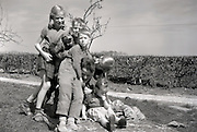 children play fighting with there father 1960s Holland