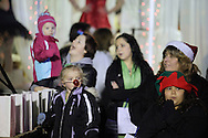 Pine Bush, New York - People, including a young girl wearing a red reindeer nose, watch the parade down Main Street at the Community Country Christmas 2011 celebration on Dec. 3, 2011.