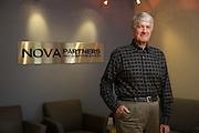 Nova Partners, Inc. associates pose for a portrait at the corporate office in Palo Alto, California, on November 7, 2014. (Stan Olszewski/SOSKIphoto)