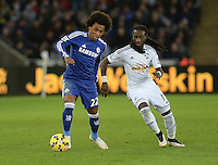 Chelsea's Willian vies for possession with Swansea City's Marvin Emnes <br /> <br /> Photographer /Ashley CrowdenCameraSport<br /> <br /> Football - Barclays Premiership - Swansea City v Chelsea - Saturday 17th January 2015 - Liberty Stadium - Swansea<br /> <br /> © CameraSport - 43 Linden Ave. Countesthorpe. Leicester. England. LE8 5PG - Tel: +44 (0) 116 277 4147 - admin@camerasport.com - www.camerasport.com