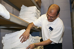 Prison officer in the stores, HMP Bronzefield, women's prison in Surrey