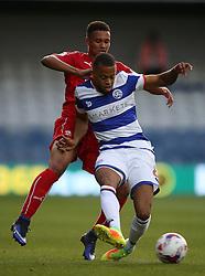 Queens Park Rangers's Jordan Cousins (right) and Swindon Town's Jermaine Hylton battle for the ball