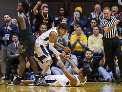 Jan 12, 2019; Morgantown, WV, USA; West Virginia Mountaineers guard Trey Doomes (0) celebrates with West Virginia Mountaineers forward Derek Culver (1) during the first half against the Oklahoma State Cowboys at WVU Coliseum. Mandatory Credit: Ben Queen-USA TODAY Sports