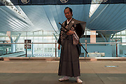 Portrait of an actor dressed as a samurai during the Edo festival at Haneda International Airport terminal, Tokyo, Japan. Friday August 26th 2016. The 3 day festival runs from August 26th to August 28th at Tokyo's second International airport. Actors dressed as samurai, geisha and ninja will greet passengers and visitors to the terminal and put on shows and parades of traditional music and dance. Haneda International airport has an Edo theme. Edo is the old name for Tokyo in the time of the samurai