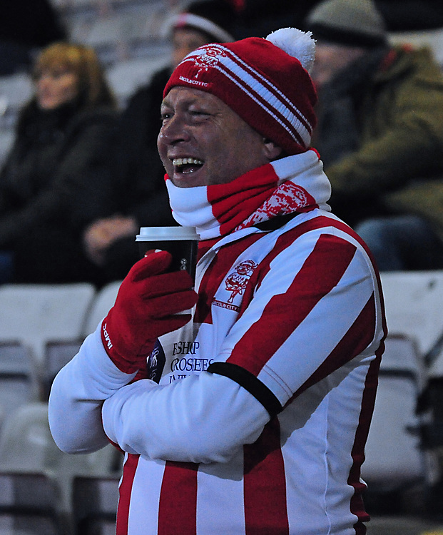 Lincoln City fans watch their team in action<br /> <br /> Photographer Andrew Vaughan/CameraSport<br /> <br /> The EFL Sky Bet League Two - Lincoln City v Cheltenham Town - Tuesday 13th February 2018 - Sincil Bank - Lincoln<br /> <br /> World Copyright © 2018 CameraSport. All rights reserved. 43 Linden Ave. Countesthorpe. Leicester. England. LE8 5PG - Tel: +44 (0) 116 277 4147 - admin@camerasport.com - www.camerasport.com