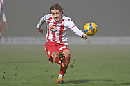 Stevenage midfielder Arthur Read(19) shoots at goal during the FA Cup match between Stevenage and Swansea City at the Lamex Stadium, Stevenage, England on 9 January 2021.