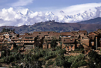 Landscape scene of village houses in Nepal with the Himalayas behind. 1969. Photographed by Terry Fincher