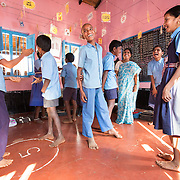 CAPTION: At the end of a classroom session, Hemavathi gets the children to do a group work exercise that reviews, in a fun way, what has been taught. This is a particularly inclusive technique, which she learned during training by The Teacher Foundation (TTF). In spite of his locomotor disability, Sidaraju (centre) feels very much a part of the action. LOCATION: Mangala (village), Kasaba (hobli), Chamrajnagar (district), Karnataka (state), India. INDIVIDUAL(S) PHOTOGRAPHED: From left to right (visible faces only): Mallikarjuna, Sidaraju, D. Mahendra, B.P. Hemavathi, S. Asha and Rachana.