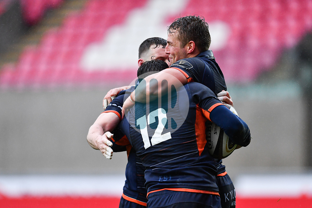 Matt Scott of Edinburgh celebrates scoring his sides second try with team-mates<br /> <br /> Photographer Craig Thomas/Replay Images<br /> <br /> Guinness PRO14 Round 11 - Scarlets v Edinburgh - Saturday 15th February 2020 - Parc y Scarlets - Llanelli<br /> <br /> World Copyright © Replay Images . All rights reserved. info@replayimages.co.uk - http://replayimages.co.uk