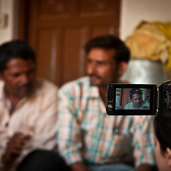 Students film an interview local farmers who work with Navdanya.
