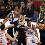 Galatasaray's Jerry JOHNSON (2ndR) and Efes Pilsen's Flip MURRAY (R), Nikola VUJCIC (L), Sinan GULER (C), Lawrence ROBERTS (2ndL) during their BEKO Basketball League derby match Galatasaray between Efes Pilsen at the Abdi Ipekci Arena in Istanbul at Turkey on Sunday, March 06 2011. Photo by TURKPIX