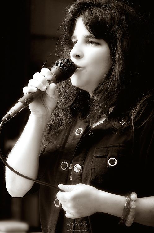 Peg Pearl, on keyboard and vocals, performing with the Vince Martell Band at The Bus Stop Music Cafe in Pitman, NJ.