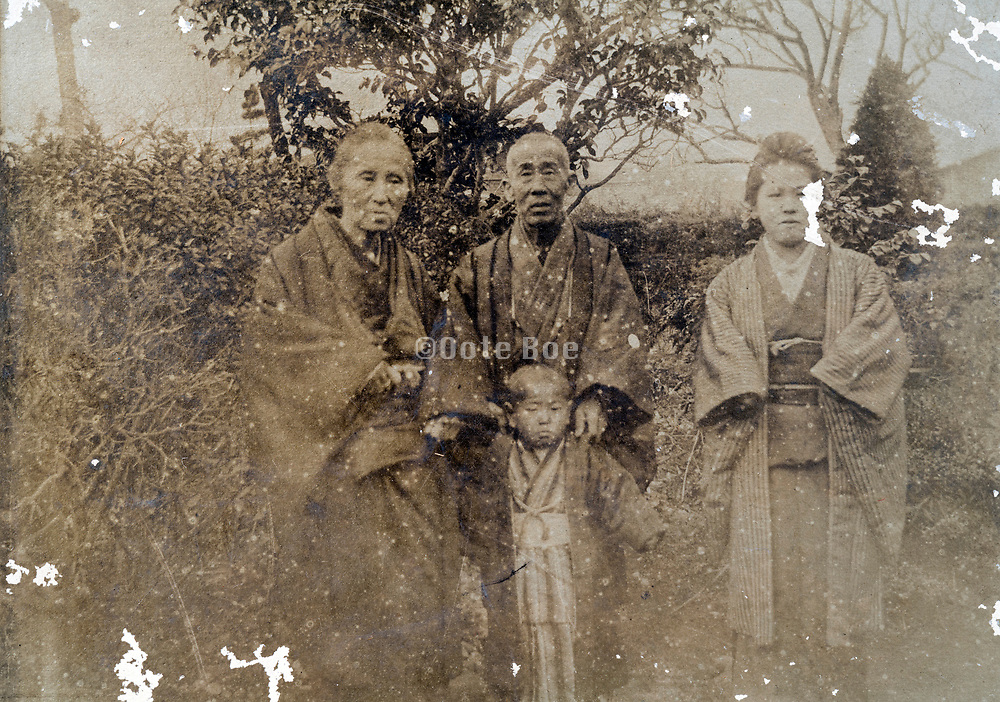 damaged and deteriorating family portait Japan ca 1930s