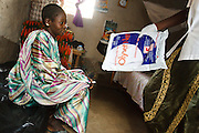 Nurse Maba N'Djim hands a treated mosquito net to Kegneba Diakite, 28, 6 mo pregnant, during a prenatal consultation in the village of Banankoro, Mali on Saturday August 28, 2010. Pregnant women receive a treated net on their first prenatal consultation..
