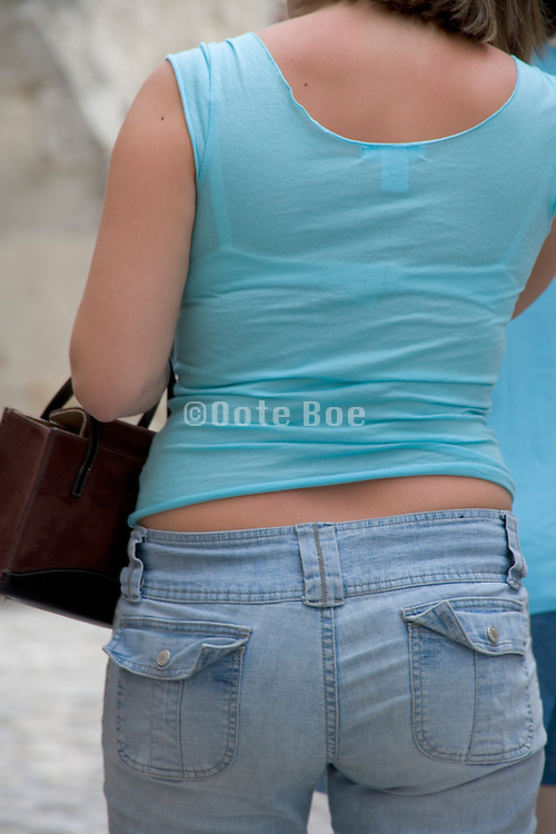 back view of a young girl summery dressed