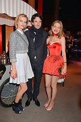 Left to right, EVA HERZIGOVA, ANTOINE ARNAULT and NATALIA VODIANOVA at 'The World's First Fabulous Fund Fair' in aid of the Naked Heart Foundation hosted by Natalia Vodianova and Karlie Kloss at The Roundhouse, Chalk Farm Road, London on 24th February 2015.