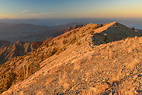 The last light of the day illuminates the summit of the 11,049 feet high Telescope Peak in Death Valley National Park.