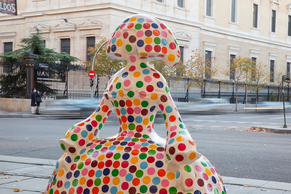 A colorful Menina figure designed and sponsored by Spanish fashion designer Ágatha Ruiz de la Prada stands at the intersection of Serrano and Jorge Juan streets, in the Salamanca neighborhood, on November 20, 2020, in Madrid, Spain. Large sculptures of Velázquez's famous characters can be found around the streets of Madrid. The initiative has been created and promoted by artist Antonio Azzato features 37 human-sized Meninas designed by himself along with other renowned artists, actors, chefs, and celebrities and sponsored by various brands and institutions.
