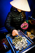 Clams being prepared for the grill at a food-stall in Hanoi, Vietnam, Asia