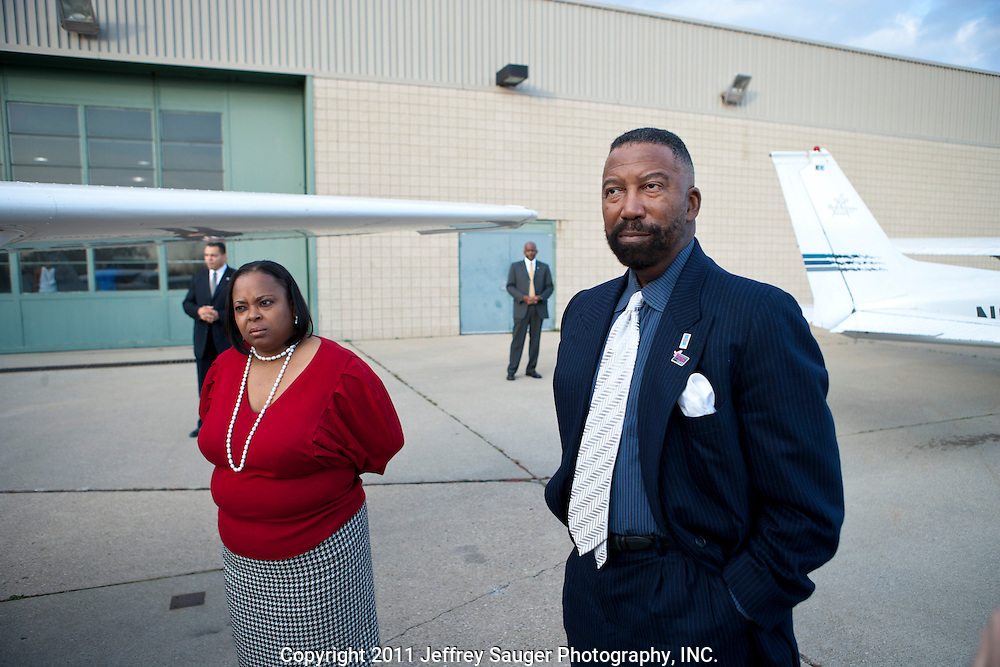DETROIT, MI - NOVEMBER, 15: Robert C. Bobb, Emergency Financial Manager of the 87,000-student Detroit Public Schools, right, and Principal Nina Graves-Hicks look at an airplane during a surprise visit to Davis Aerospace Technical High School, in Detroit, MI, Monday, November 15, 2010. Behind them are Steve Wasko, Chief Communications Officer of DPS,  and a member of Bobb's security detail.(Photo by Jeffrey Sauger)