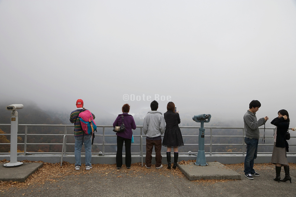 looking at mountain view in foggy weather