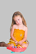 Insulted young girl of 3 on plain background