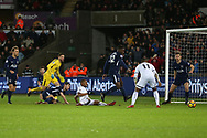 Tottenham goalkeeper Hugo Lloris is beat as Swansea city's Jordan Ayew (on ground) and Luciano Narsingh (11) go close to scoring in the 2nd half.  Premier league match, Swansea city v Tottenham Hotspur at the Liberty Stadium in Swansea, South Wales on Tuesday 2nd January 2018. <br /> pic by  Andrew Orchard, Andrew Orchard sports photography.
