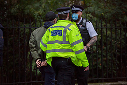 © Licensed to London News Pictures.10/12/2020. London, UK. A man is detained as a cordon remains in a place as police continue to investigate after pupils and staff at Stoke Newington School in north London have been evacuated after revived a bomb threat around 11:55am. It is unclear what the man was detained for.  Photo credit: Marcin Nowak/LNPPhoto credit: Marcin Nowak/LNP