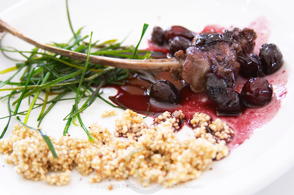 grilled lamb chops with cherry sauce and traditional Quinoa, traditional Inca grain grown at 3000 meters altitude, and fried leeks Bodega Del Anelo Winery, also called Finca Roja, Anelo Region, Neuquen, Patagonia, Argentina, South America