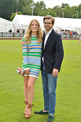 JAMES TROUGHTON and CLEMENTINE NICHOLSON at the Cartier Queen's Cup Final 2016 held at Guards Polo Club, Smiths Lawn, Windsor Great Park, Egham, Surrey on 11th June 2016.
