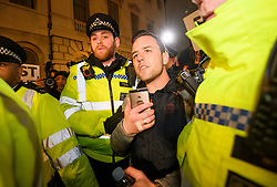 """© Licensed to London News Pictures. 15/01/2019. London, UK. An anti EU campaigner DANNY """"TOMMO"""" is arrested by police outside Parliament in Westminster, London, on the day that MP's will vote on British Prime Minster Theresa May's proposed transition deal with the EU on the UK's exit from the European Union. Photo credit: Ben Cawthra/LNP"""