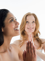 Jul. 26, 2012 - Two women in prayer pose (Credit Image: © Image Source/ZUMAPRESS.com)