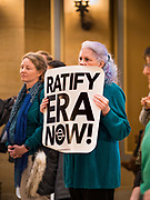 05 MARCH 2020 - ST. PAUL, MINNESOTA: A woman listens to a speaker during a pro-ERA rally in the rotunda at the Minnesota State Capitol. About 75 people, mostly women, came to the capitol to support ratification of the Equal Rights Amendment and mark the local observance of International Women's Day. International Women's Day is celebrated on March 8 around the world.       PHOTO BY JACK KURTZ