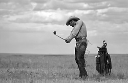 cowboy golfing on a ranch in New Mexico