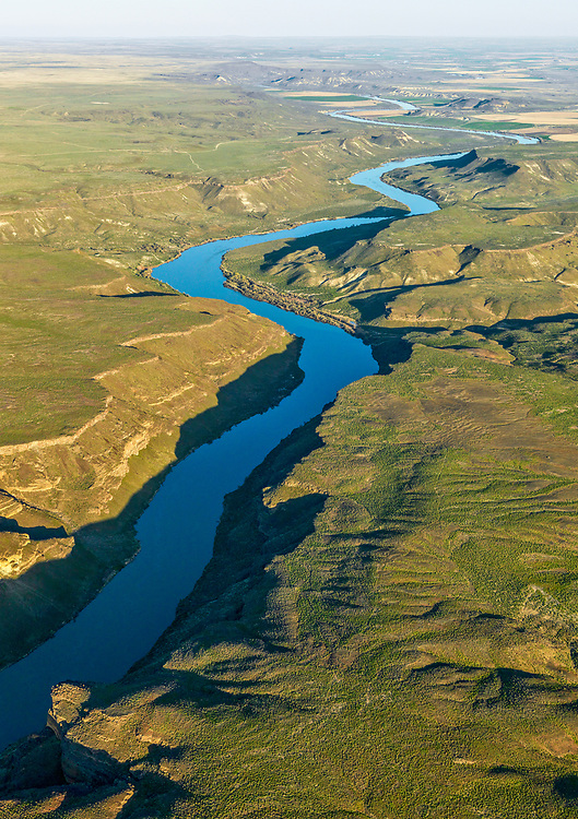 Snake River Aerial view in Springtime south of Boise Idaho in the last evening light looking toward the southeast.  Licensing and Open Edition Prints.