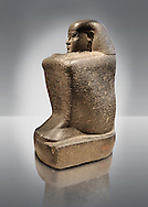 Ancient Egyptian granite block statue of the steward Haruafrom Thebes. 26th Dynasty 500 BC. Neues Museum Berlin AM 8163. .<br /> <br /> If you prefer to buy from our ALAMY PHOTO LIBRARY  Collection visit : https://www.alamy.com/portfolio/paul-williams-funkystock/ancient-egyptian-art-artefacts.html  . Type -   Neues    - into the LOWER SEARCH WITHIN GALLERY box. Refine search by adding background colour, subject etc<br /> <br /> Visit our ANCIENT WORLD PHOTO COLLECTIONS for more photos to download or buy as wall art prints https://funkystock.photoshelter.com/gallery-collection/Ancient-World-Art-Antiquities-Historic-Sites-Pictures-Images-of/C00006u26yqSkDOM