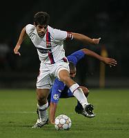 Photo: Paul Thomas.<br /> Lyon v Rangers. UEFA Champions League, Group E. 02/10/2007.<br /> <br /> Juninho (L) gets past Daniel Cousins of Rangers.
