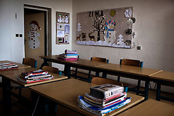 "An empty classroom is seen inside Zakladni Skola in Ostrava, Czech Republic on March 1, 2012.  Several of the 18 Roma children who were represented in the D.H. and Others v. Czech Republic case, the first challenge to systemic racial segregation in education to reach the European Court of Human Rights, attended this school. When this case was first brought in 2000, Roma children in the Czech Republic were 27 times more likely to be placed in ""special schools,"" intended for the mentally disabled, than non-Roma children. In 2007, the Grand Chamber of the European Court of Human Rights ruled that this pattern of segregation violated nondiscrimination protections in the European Convention on Human Rights. Despite this landmark decision, little change has occurred: the ""special schools"" have been renamed but follow the same substandard curriculum and Roma continue to be assigned to these schools in disproportionate numbers. The process of integration has barely begun."