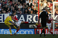 Photo: Lee Earle.<br /> Charlton Athletic v Liverpool. The Barclays Premiership. 16/12/2006. Liverpool's Steven Gerrard (L) scores their third.