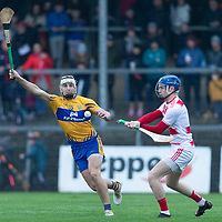 Cork's goalie Pa Collins is blocked by Clare's Aaron Shanagher